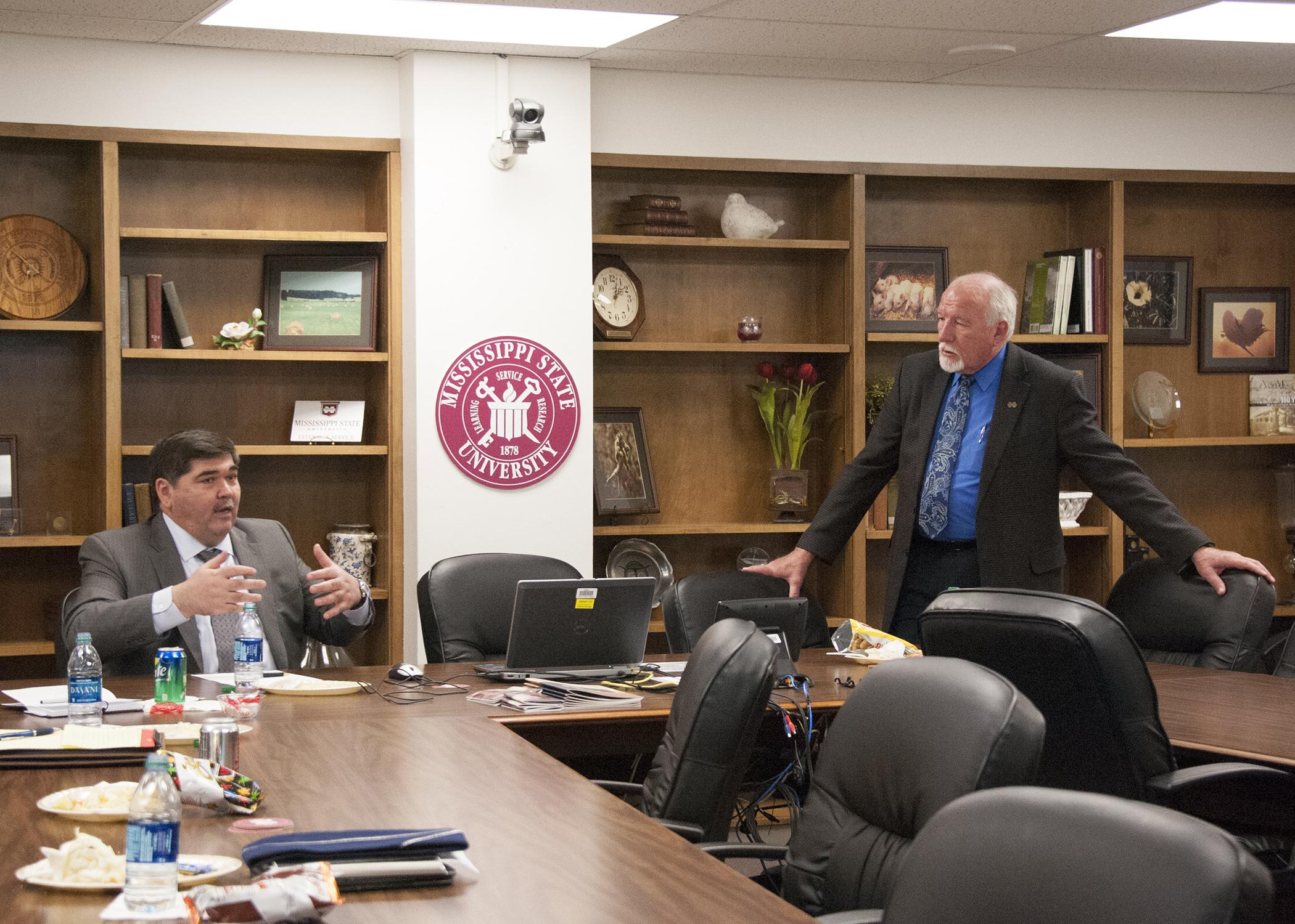 H.E. Bakhtiyar Gulyamov, left, speaks during a meeting with Bill Herndon, associate vice president of the Mississippi State University Division of Agriculture, Forestry and Veterinary Medicine April 15, 2015. Gulyamov is Ambassador Extraordinary and Plenipotentiary of the Republic of Uzbekistan to the United States. (Photo by MSU Extension Service/Kat Lawrence)