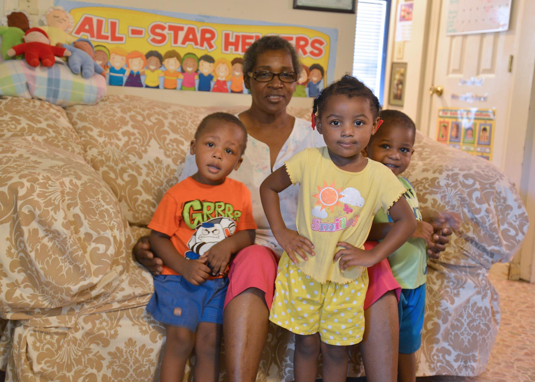 Katherine Weatherby is surrounded by her 2-year-old grandchildren (from left) Zirean Davis, G'Niereya Alston and Bryson Ward at her home in Sallis, Mississippi, on Aug. 20, 2015. (Photo by MSU Human Sciences/Amy Barefield)