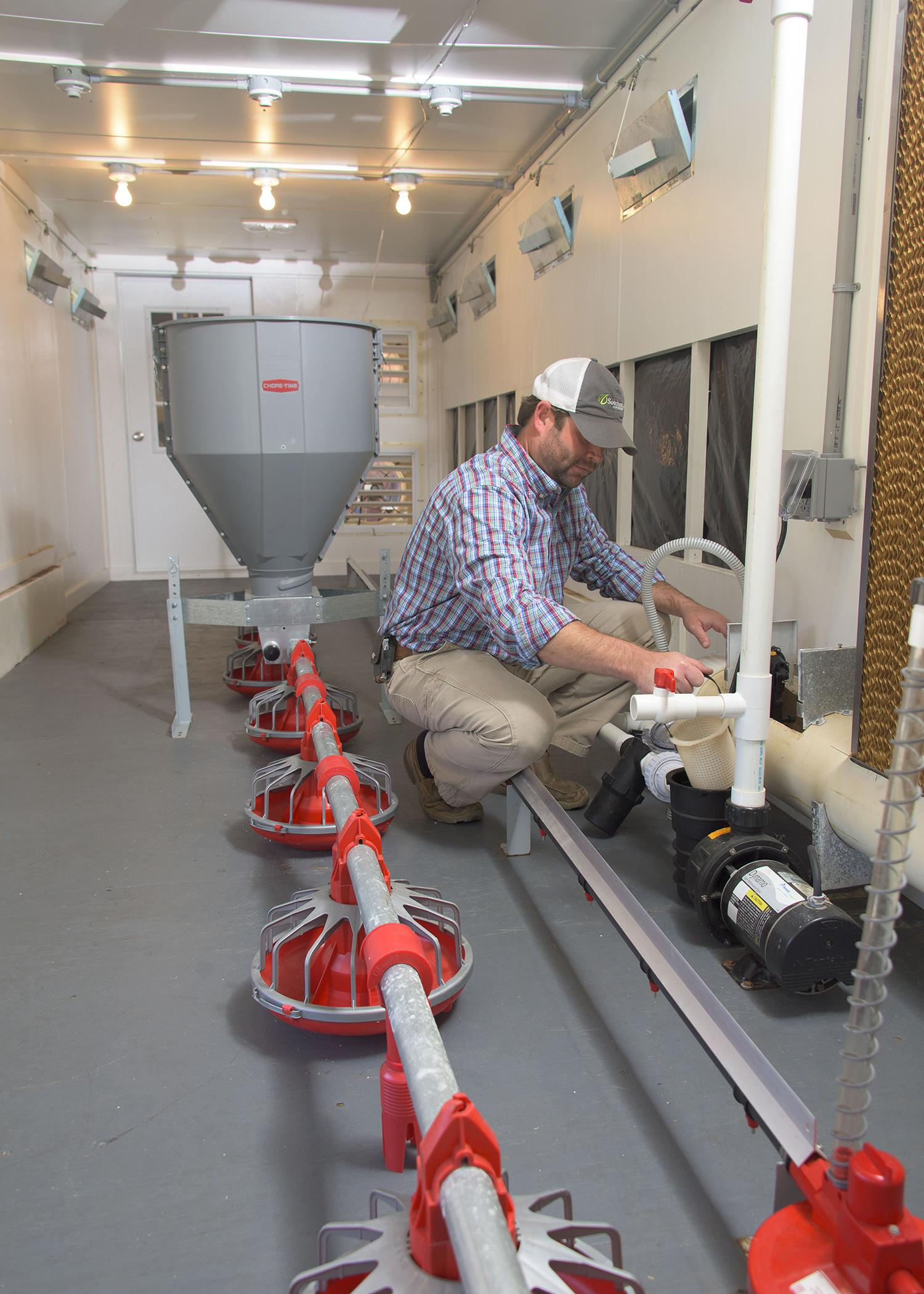 Mississippi State University research associate Daniel Chesser tests a new pumping unit inside the Mobile Environmental and Energy Lab at Mississippi State University Oct. 29, 2015. (Photo by MSU Extension/Kevin Hudson)
