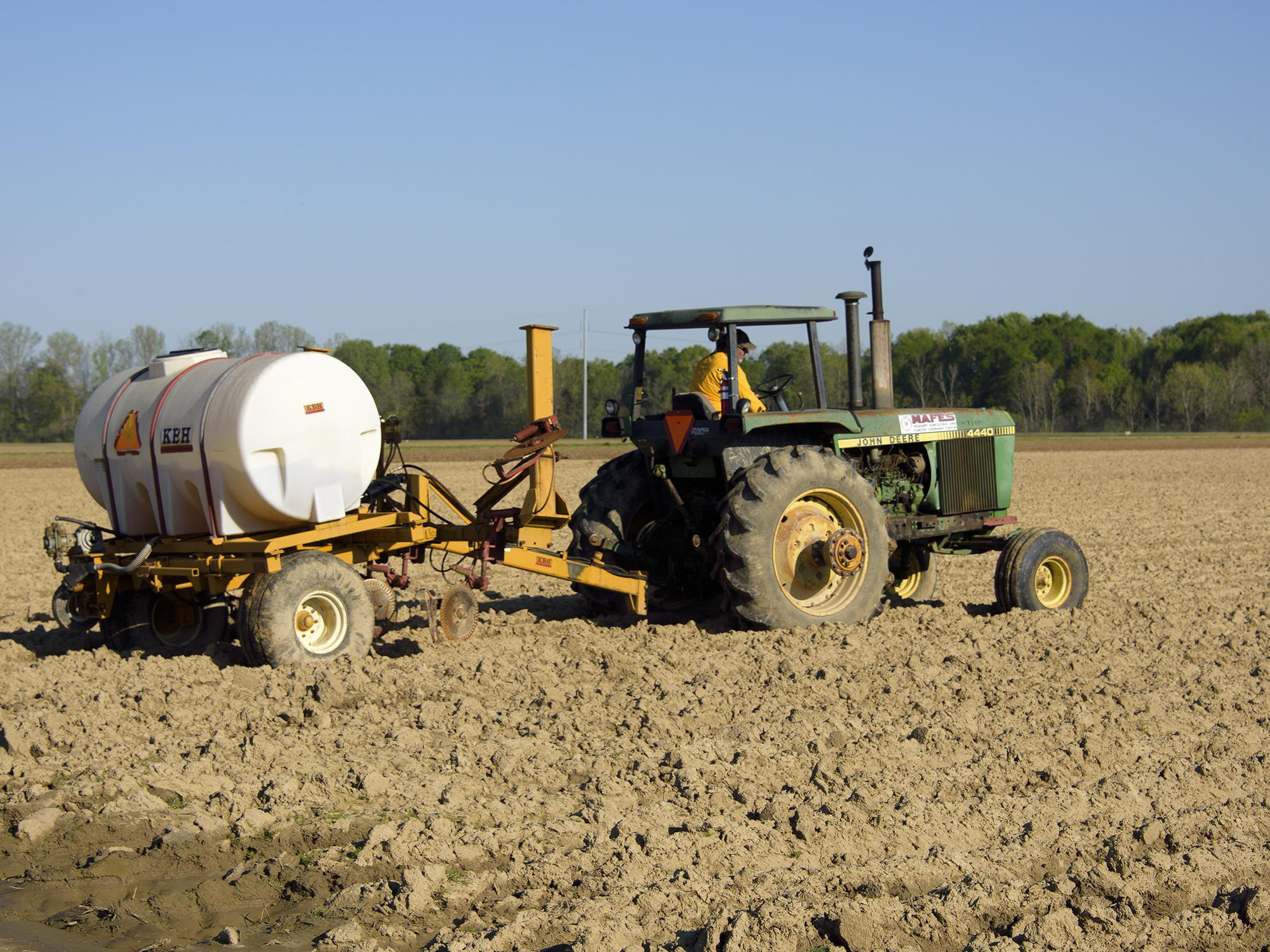 Eddie Stevens, farm supervisor at Mississippi State University's R. R. Foil Plant Science Research Center in Starkville, was applying a liquid fertilizer to a corn field on April 5, 2016. Correct application of nutrients is a key part of environmental stewardship and efficient farm management. (Photo by MSU Extension Service/Kevin Hudson)