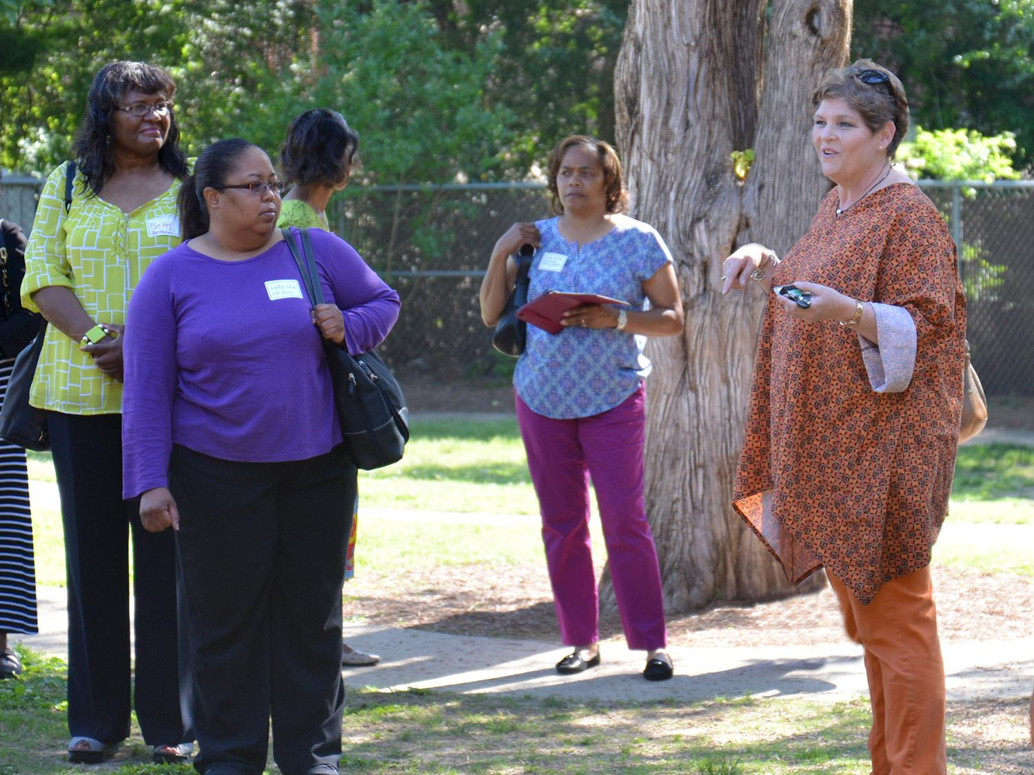 The Mississippi State University Aiken Village Preschool director Lucy Bryant, on right, led a tour of the facility and playground for a group of early care and education providers interested in quality improvements. (Submitted photo)