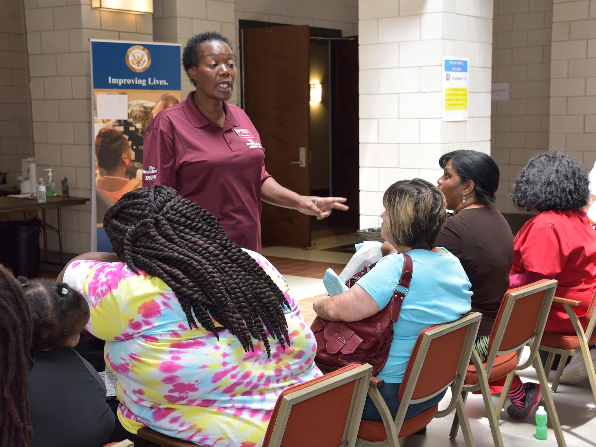 Dannie Bolden, Wilkinson County nutrition educator with the Mississippi State University Extension Service, speaks to participants of the wellness event about reducing fat and sugars in their diets in Natchez, Mississippi, on Aug. 9, 2016. (Photo by MSU Extension Service/Kevin Hudson)