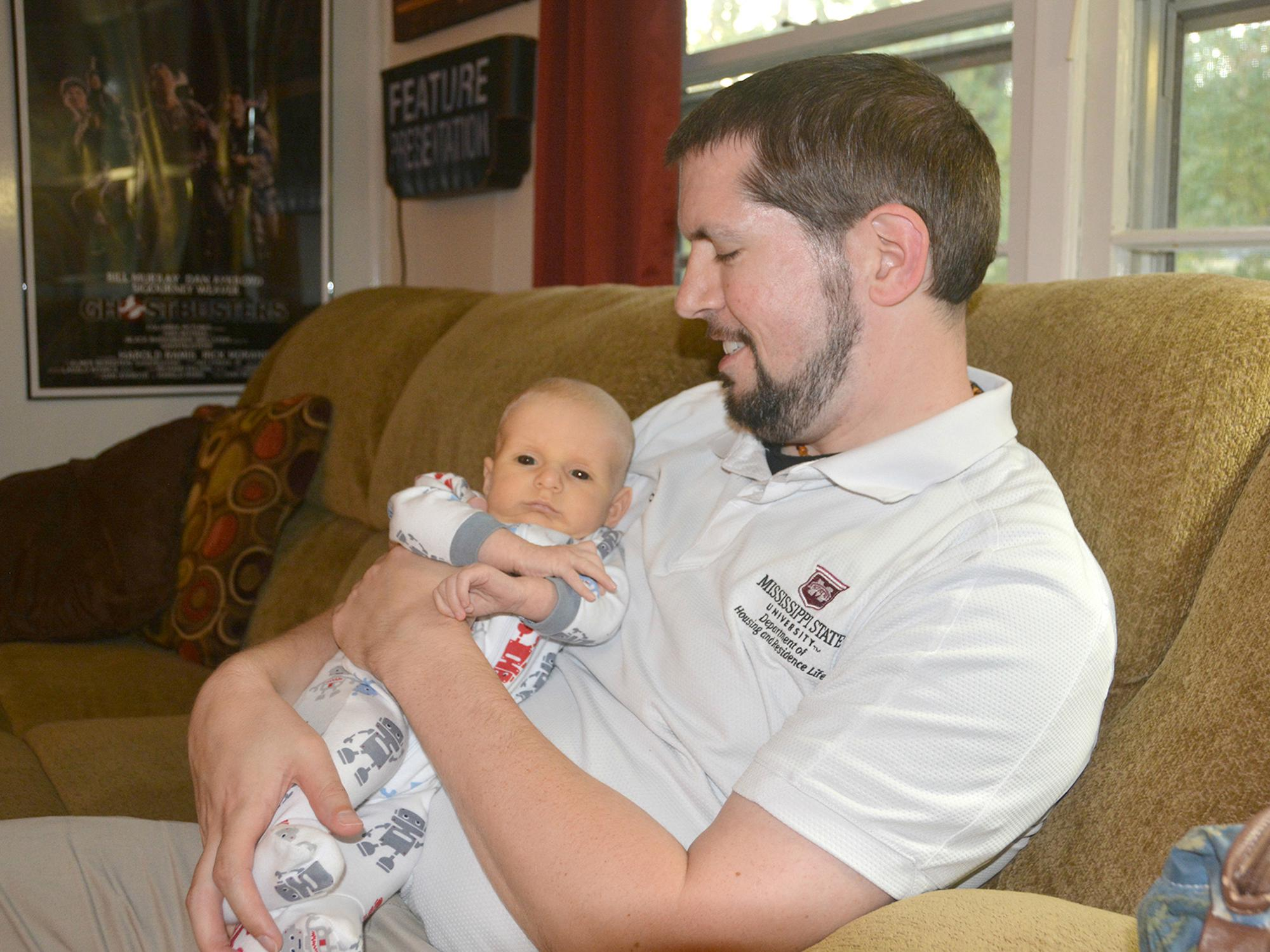 Boone Purser enjoys afternoon cuddles with his son, Benji, on Oct. 31, 2016. Benji is a breastfed baby who thrives on attention from both his parents at his home in Starkville, Mississippi. (Photo by MSU Extension Service/Linda Breazeale)