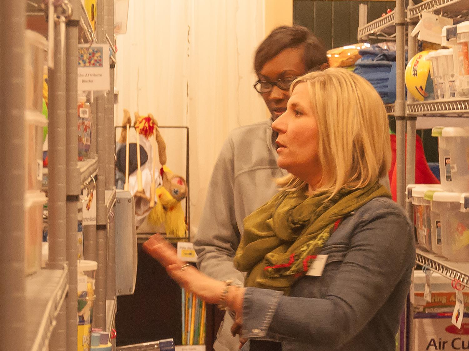 Chrissie Ryals, an Extension associate with the Early Years Network, guides a local resident through resources available at the Central Mississippi Resource and Referral Center in Canton, Mississippi. (MSU Extension Service file photo)