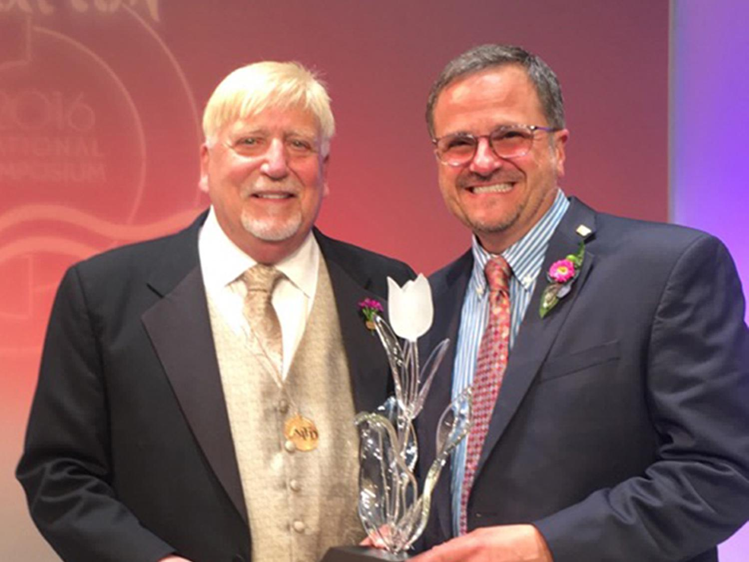 Mississippi State University Extension Service floral design specialist Jim DelPrince, right, accepted the American Institute of Floral Designers Award of Distinguished Service to the Floral Industry from Awards Committee Chairman Rich Salvaggio during the organization's annual National Symposium in July. (Photo courtesy of American Institute of Floral Designers)