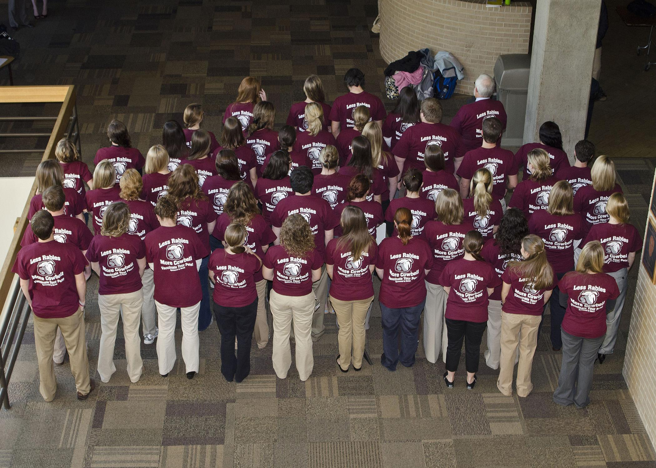 "The Mississippi State University College of Veterinary Medicine's Class of 2016 rings out the rabies prevention message with the tag line, ""Less Rabies, More Cowbell."" The class performed several outreach and education projects and won the honor of hosting the annual Merial Rabies Symposium. (Photo by College of Veterinary Medicine/Tom Thompson)"