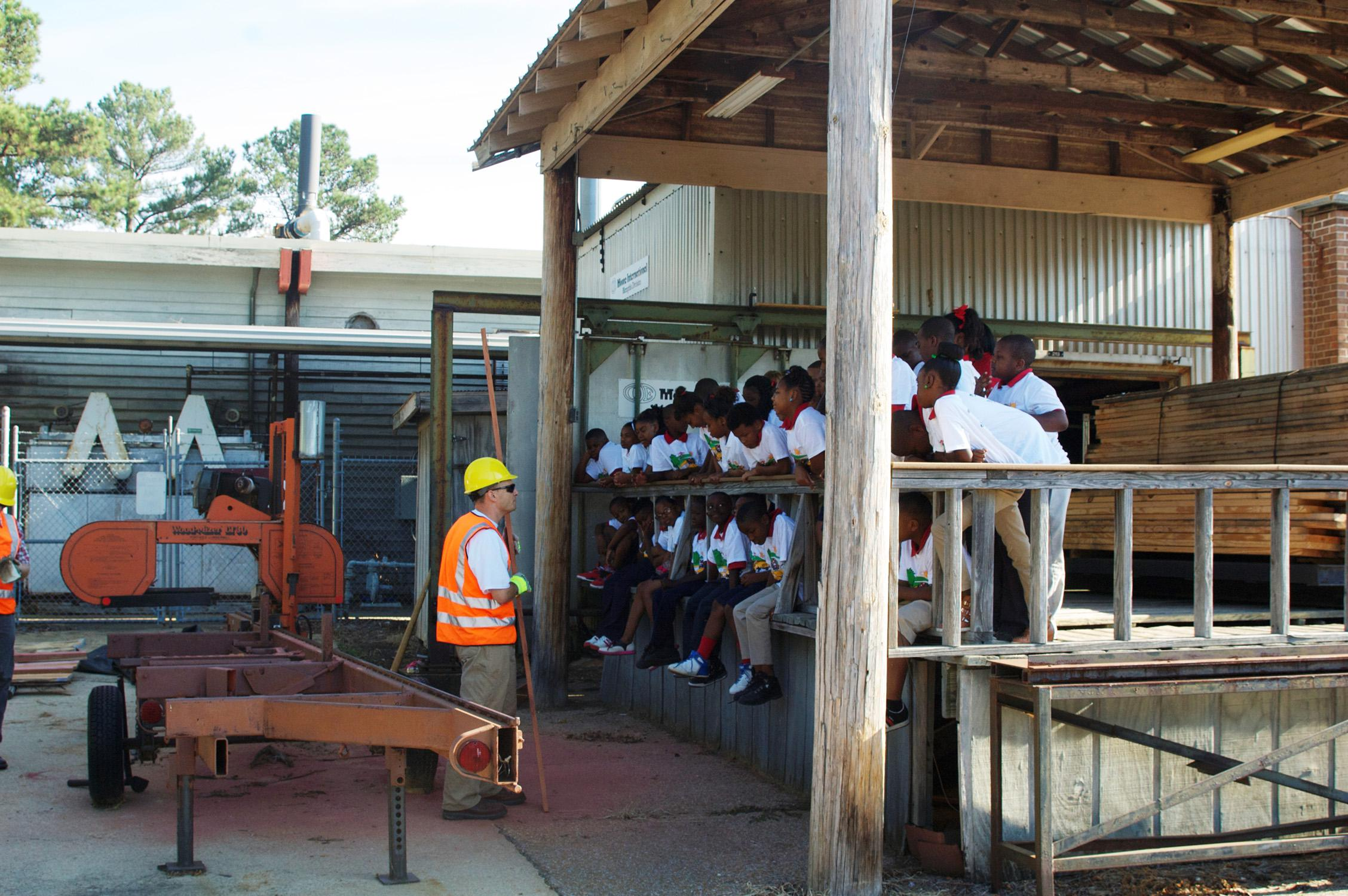 Mississippi State University Sustainable Bioproducts department head Rubin Shmulsky tells students at the 2013 Wood Magic Fair sawmill station about lumber manufacturing. (College of Forest Resources/File photo)