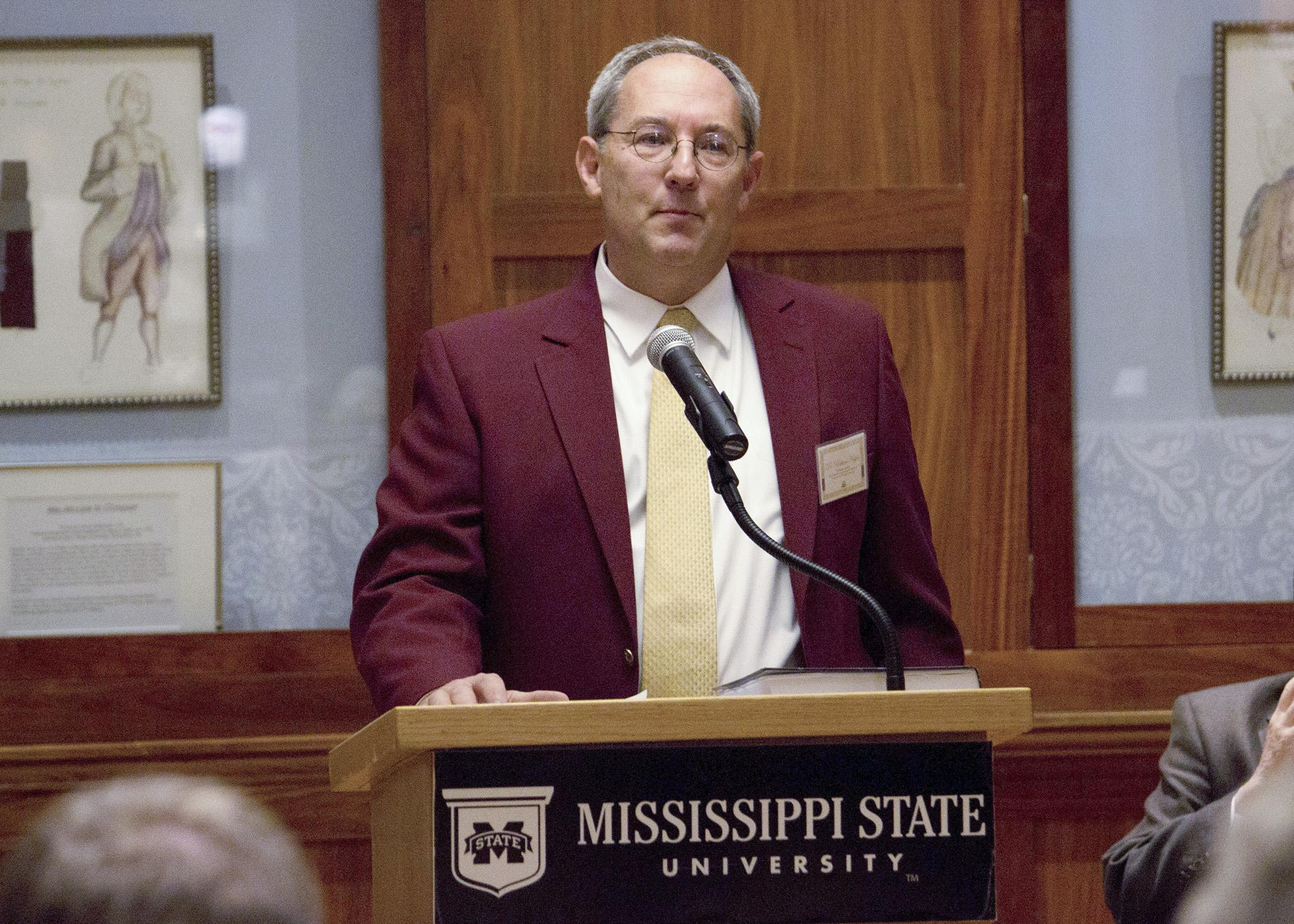 "Dr. Richard Hopper, professor at the Mississippi State University College of Veterinary Medicine, thanks contributing authors and his family at an event hosted by the MSU Mitchell Memorial Library to celebrate the publication of his book, ""Bovine Reproduction."" (Submitted Photo)"