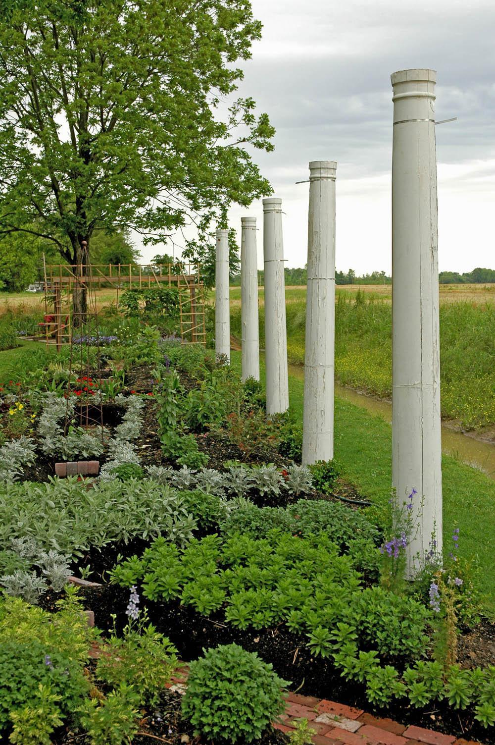 garden columns. columns from a former home provide ghostly southern archaeological feel to the edge of this garden e