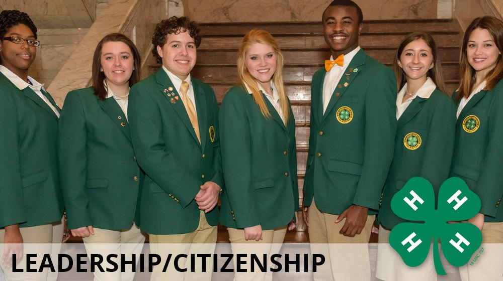 Seven 4-H leaders wearing green coats while receiving awards.