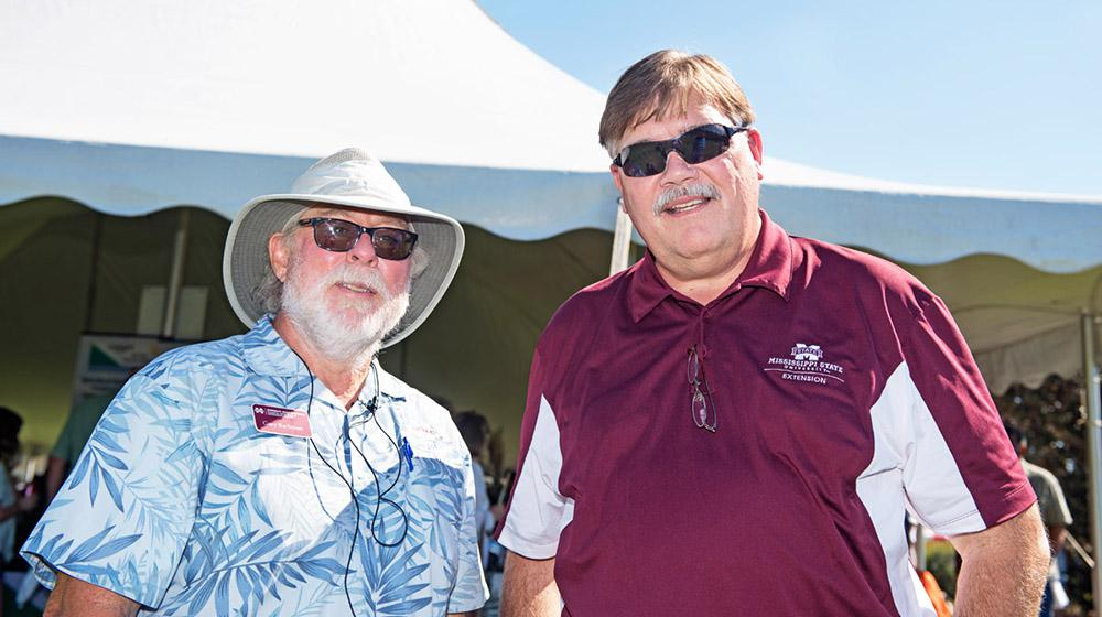 Drs. Gary Bachman and Gary Jackson in front of tent at Fall Flower & Garden Fest.