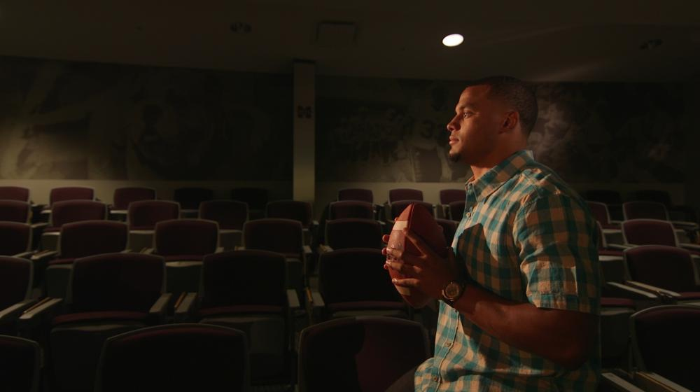 Dak holding a football during the Colon Cancer Screening PSA shoot.