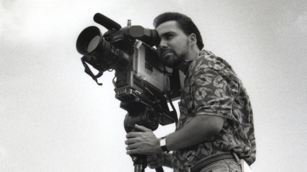 Man using an old television camera.
