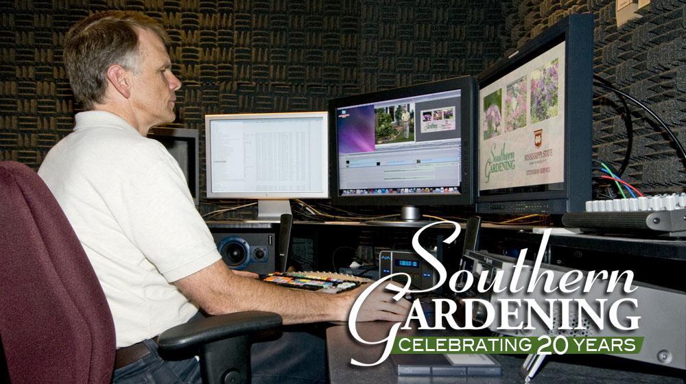 Man sitting at tv edit station.