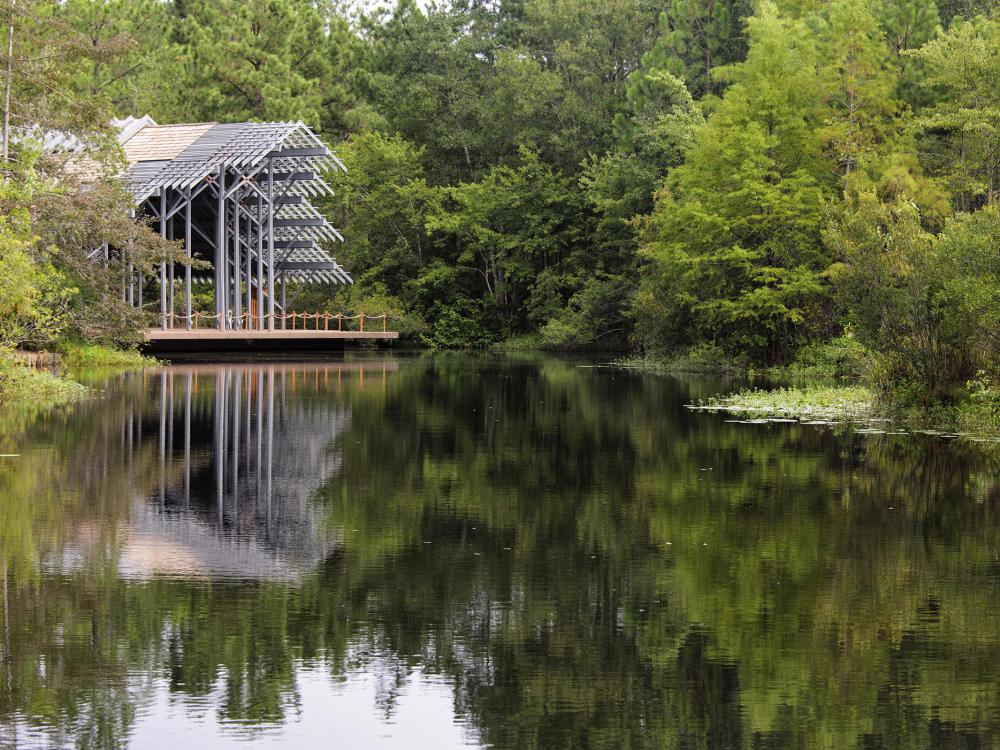 The Pinecote Pavillion stands in the background of the pond at the Crosby Arboretum.