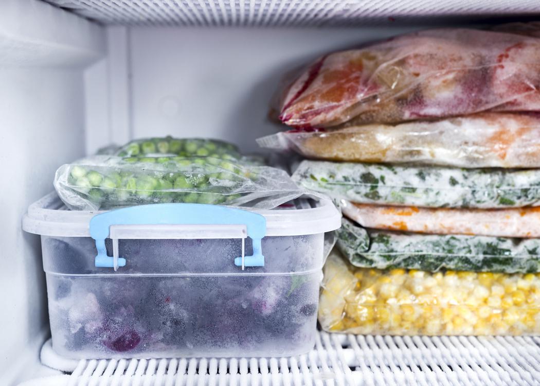 Frozen foods sit in the freezer.