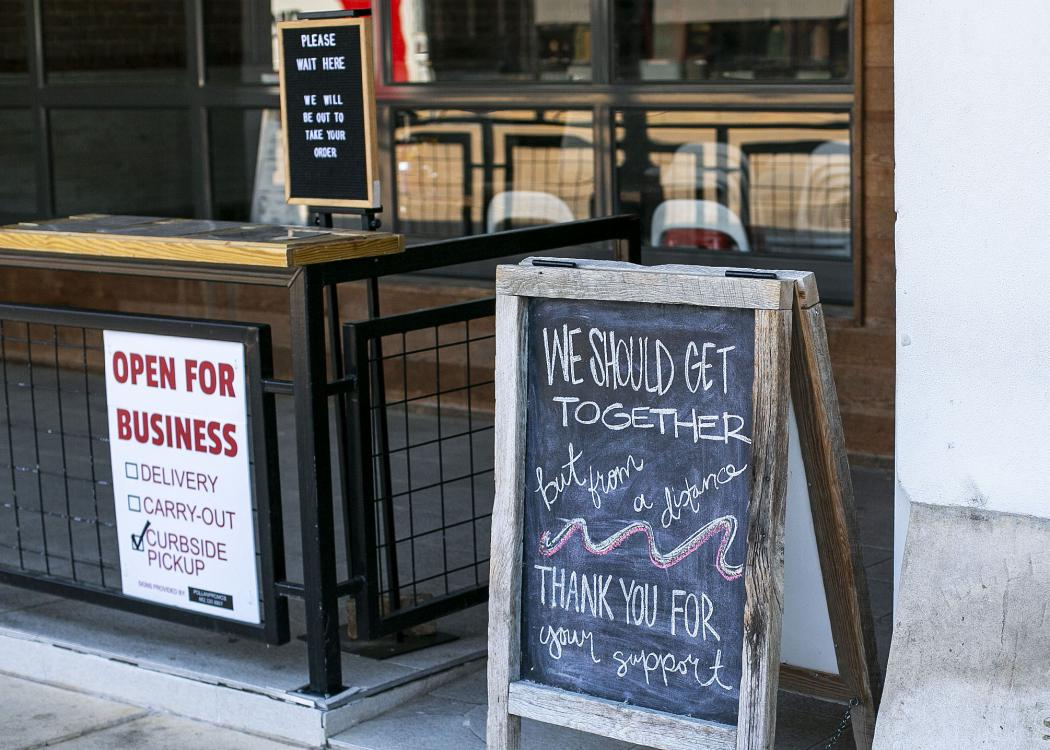 Signs with instructions for ordering curbside greet customers at a local coffee shop