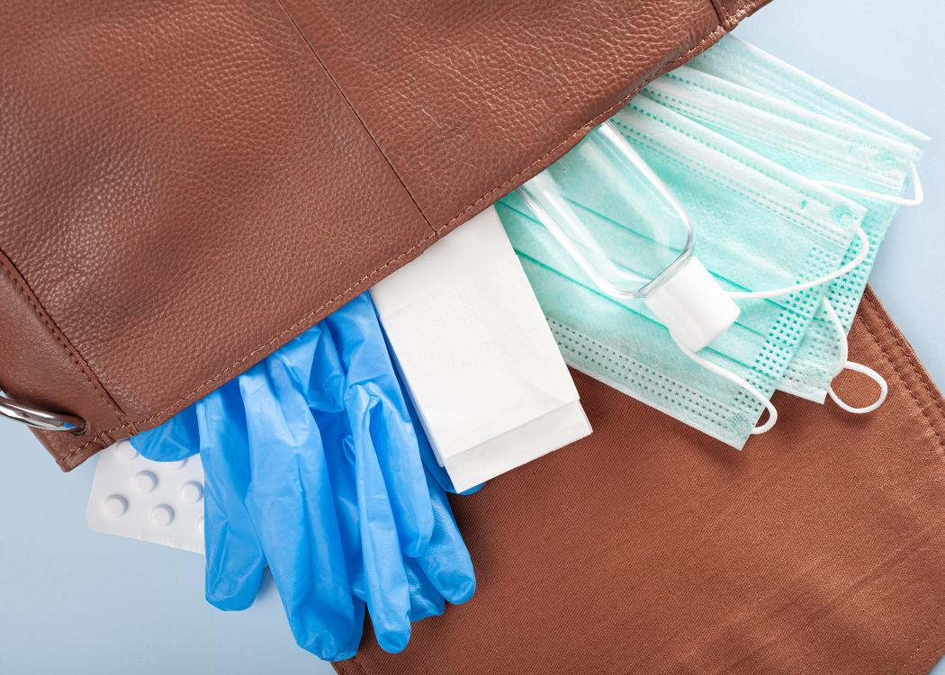 Protective medical mask, sanitizer gel and gloves in bag.