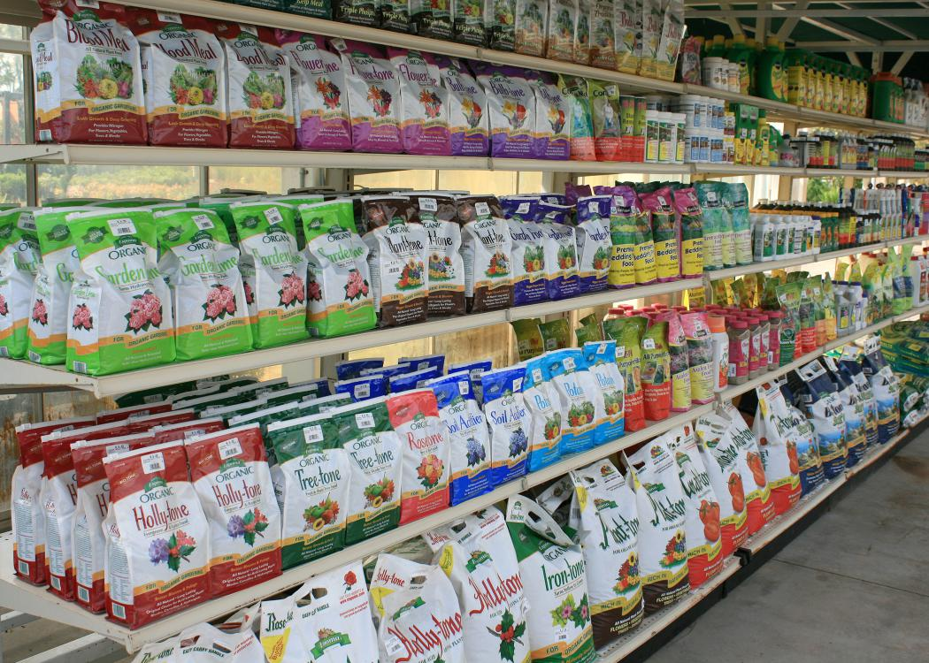 Rows of bagged items line the shelves in a store.