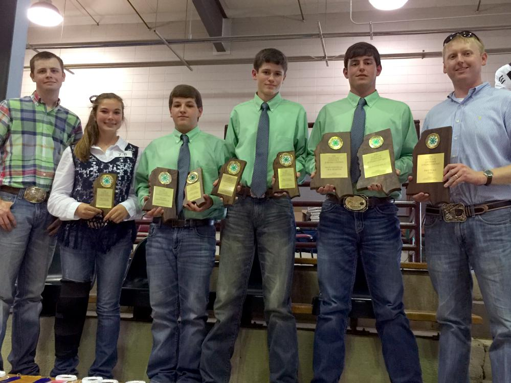 Tucker Wagner, far left, a graduate student in the Mississippi State University Department of Animal and Dairy Sciences, and Brett Crow, far right, an instructor in the department and coach of the MSU Livestock Judging Team, are pictured with the Lincoln County 4-H team at the statewide 4-H/FFA livestock judging contest. The event was held at the MSU Horse Park in Starkville, Mississippi, on May 21, 2016. Team members from left are Rylie Melancon, Walker Williams, Jacob Johnson and Will Watts. (Submitted Ph
