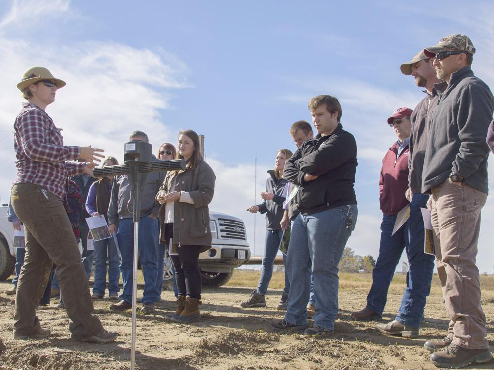 Rachel Stout Evans, a soil scientist with the Natural Resources Conservation Service, speaks to Mississippi State University Extension agents at a row crop farm in Shaw, Mississippi.