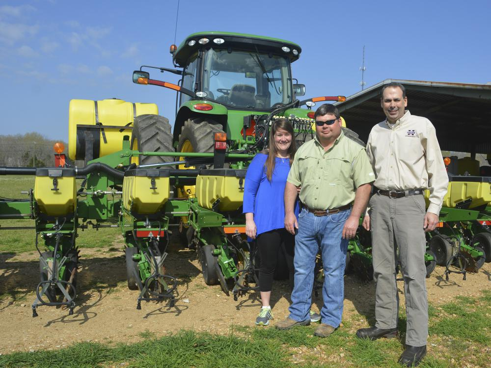 Molly and Brad Judson of Clay County are one of four couples who recently earned the National Outstanding Young Farmers award. They were nominated by Charlie Stokes, right, their Mississippi State University Extension Service agent, for the recognition from the National Association of County Agricultural Agents. (Photo by MSU Extension Service/Linda Breazeale)