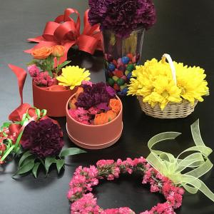 A variety of colorful, small-sized floral arrangements and projects.
