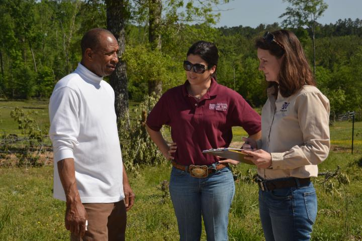 Winston County farmer Willie Lee Jr. discusses his losses from the April 28 tornado with Mississippi State University Extension Service disaster assessment team members Brandi Karisch (center) and Jane Parish, both of MSU's Department of Animal and Dairy Sciences. (Photo by MSU Ag Communications/Linda Breazeale)