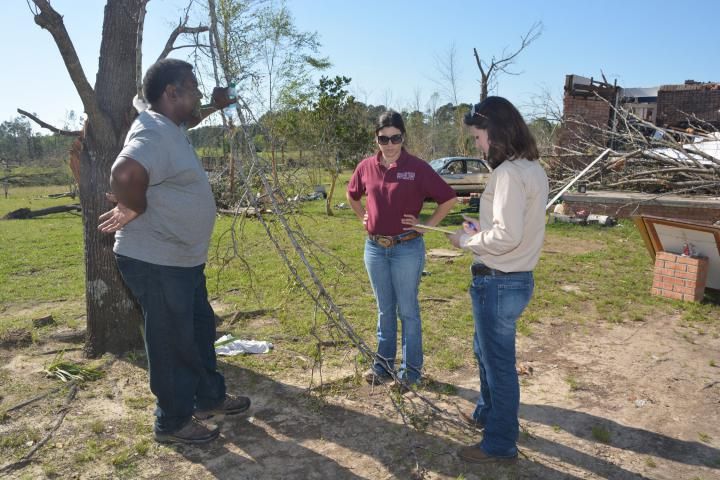 Clifton Haynes shares information about the structures and animals he lost on his farm near Louisville with Mississippi State University Extension Service disaster assessment team members Brandi Karisch (center) and Jane Parish, both of MSU's Department of Animal and Dairy Sciences. (Photo by MSU Ag Communications/Linda Breazeale)