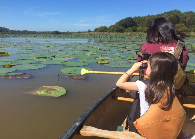 Simply taking children outside will open their eyes and hearts to the outdoors. While canoeing with adults on Bluff Lake in Noxubee County, Mississippi, this child searched for alligators and birds with her binoculars. (Photo by MSU Extension Service/Evan O'Donnell)