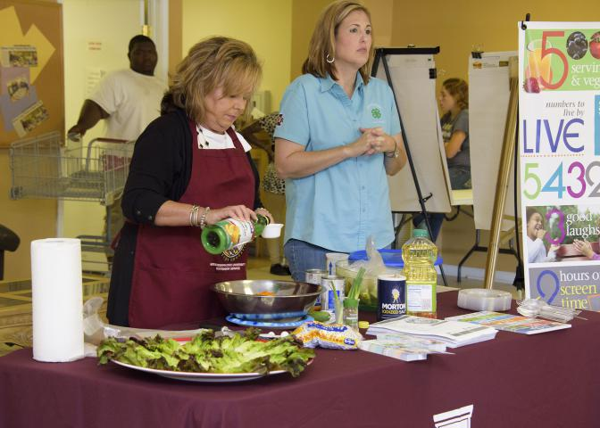 Angie Crawford, left, and Mari Alyce Earnest of the Mississippi State University Extension Service office in Quitman County deliver a nutrition education program Sept. 13, 2016, at the community center in Lambert, Mississippi. Extension works with several area organizations to provide food for about 800 underserved families every other month. (Photo by MSU Extension Service/Kevin Hudson)