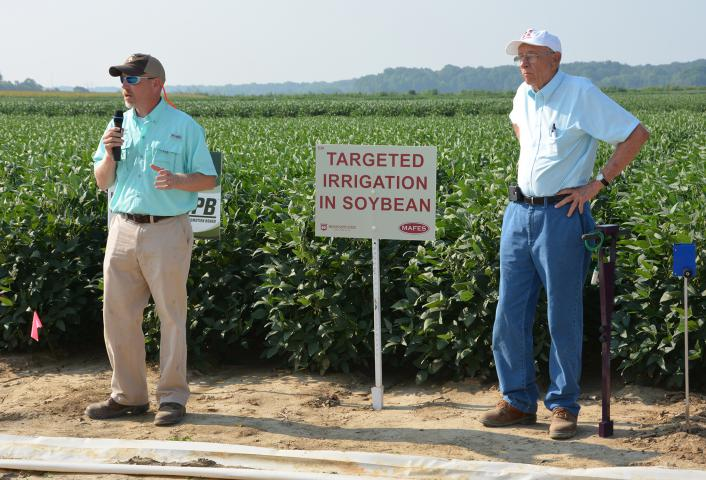 Jason Krutz (left), irrigation specialist for the Mississippi State University Extension Service, and Normie Buehring, research professor at the Northeast Mississippi Experiment Station, discuss soybean irrigation at the 2014 North Mississippi Research and Extension Center Agronomic Row Crops Field Day. The biennial event will be Aug. 11, 2016 in Lee County. (File Photo/ MSU Extension Service)