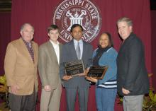 The Mississippi Agricultural and Forestry Experiment Station and the Mississippi State University Extension Service have presented 2006 Outstanding Worker Awards to K. Raja Reddy and Grenell Rogers. Reddy, center, is a research professor in the Department of Plant and Soil Sciences and Rogers, second from right, is an area Extension agent in Oktibbeha County. Presenting the awards were MSU Vice President for Agriculture, Forestry and Veterinary Medicine Vance Watson, left, Land Bank of North Mississippi Loa
