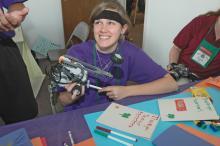 Robotics competitor Keelan Ready, of Hernando, checks programming adjustments on her team's robot. (Photo by Patti Drapala)