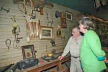 Tom Wilburn and Jeannine Smith spend hours exploring the history of farm life long ago near Artesia and Wilburn's experiences in the harness-racing industry. (Photo by Linda Breazeale)