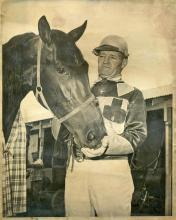 Tom Wilburn, a 1940 animal husbandry graduate from Mississippi State College, is pictured many years ago with his harness-race horse, Trotwood Roy. (Submitted photo)