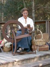 Yvette Rosen demonstrates spinning to guests of a previous Piney Woods Heritage Festival at Crosby Arboretum. The festival provides an opportunity to learn about the arts and heritage crafts of the region. (Photo courtesy of Crosby Arboretum)
