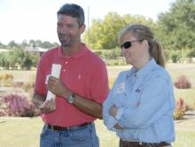 Dan Batson, owner of GreenForest Nursery, visits with Patricia Knight, head of the Mississippi State University Coastal Research and Extension Center, at the 2010 Ornamental Horticulture Field Day. (Photo by Cheree Franco)