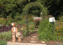 The entrance to the Hill Garden is highlighted by a figure made from flower pots, a covered archway and a mailbox. (Photos by Patti Drapala)