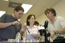 Each fall, scientists from all over the world flock to Mississippi State University to learn the latest in insect-rearing techniques. Blaine Junfin of Kunafin Insectaries and international participants Tara Van Beelen and Neil Naish identify insect pathogens in an MSU lab. (Photo by Kat Lawrence)