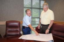 Gary Lawrence and Roger King of Mississippi State University analyze a map showing nematode sample locations and reflectance data to determine areas of high nematode populations. (Photos by Kat Lawrence)