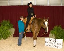 Brooke Ware of Brandon was the amateur all-around high-point winner at the Mississippi State University Bulldog Classic AQHA show. She is pictured with coach Shon Ghee of McBeath Quarter Horses.
