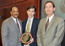 The Mississippi Board of Trustees of the State Institutions of Higher Learning recently presented Dr. Mark Lawrence with the Black History Month Educator of the Year award for Mississippi State University's Division of Agriculture, Forestry and Veterinary Medicine. Pictured: Trustee Bob Owen, co-chair of the Diversity Committee, Lawrence and Greg Bohach, DAVFM vice-president. (Submitted Photo)