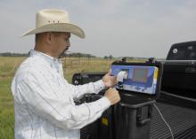 Mississippi State University Extension Service forage specialist Rocky Lemus examines a bermudagrass analysis from a portable forage tester on May 21, 2012, at the Henry H. Leveck Animal Research Farm, the forage unit at MSU's South Farm in Starkville. Forage and cattle producers can use test results to make harvest and feed supplement decisions. (Photo by MSU Ag Communications/Linda Breazeale)