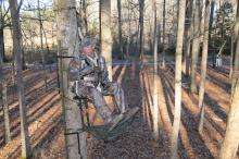 John Louk with the Treestand Manufacturer's Association demonstrates a properly secured safety harness when using a lock-on tree stand. (Photo courtesy of the Treestand Manufacturer's Association)