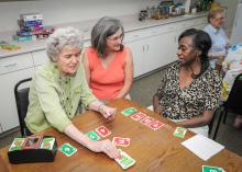 Georgia Murphy (center) observes a friendly card game between Florence Romero (left) and Bobbie Potts at the senior center on May 21, 2013, in Starkville, Miss. (Photo by MSU Ag Communications/Scott Corey)