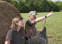 Ashley Ward with Ducks Unlimited and John Long with the Mississippi State University Extension Service model proper eye and ear protection for dove hunting. (Photo by MSU Ag Communications /Kat Lawrence)