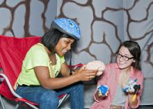 Mississippi State University secondary-education teacher candidate Ann Claire Blakely, right, teaches Studio School student LaGlotrice Jordan in the Body Walk brain room in June 2013. The Studio School hosts Body Walk with help from the MSU Extension Service and the MSU Center for the Advancement of Service-Learning. (Submitted photo)