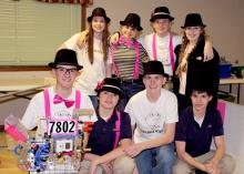 """The """"Challenge Accepted"""" robotics team celebrates winning the Feb. 7-8, 2014, state competition in Oxford, Miss. They include (front row, from left) Nathan Rodgers (holding Geoff the robot), Cade Holliday, Will Gaines and Chandler Holliday, and (back row, from left) Jill Gautier, Skyler Smith, Jon Rodgers and Paige Gautier. (Submitted Photo)"""