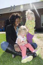 Samantha Jones enjoys a sunny afternoon with young students at the Child Development and Family Studies Center at Mississippi State University. Jones is one of more than 5,000 early care and education providers in the state of Mississippi. May 9 is Provider Appreciation Day, which is celebrated each year on the Friday before Mother's Day to recognize service providers and educators of young children. (Photo by MSU School of Human Sciences/Alicia Barnes)